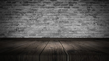 Cellar, Lit By A Searchlight. Brick White Wall And Wooden Floor