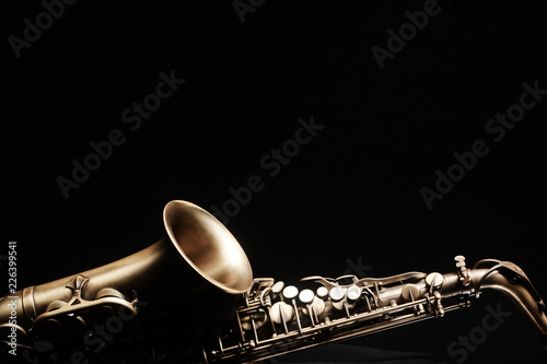 Door stickers Music Saxophone jazz instruments. Alto sax isolated