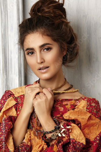 Beautiful Woman With Hairstyle Middle Bun With Brown Hair