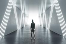 Female Hacker In Futuristic Hallway