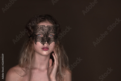 Beautiful young tender woman posing isolated over dark beige chocolate  brown background wall wearing carnival cat 757aa347e02