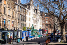 Historic Buildings With Colourful Shopfronts In Edinburgh Old Town On A Sunny Winter Day