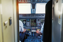 Dashboard Of Cockpit With Pilots