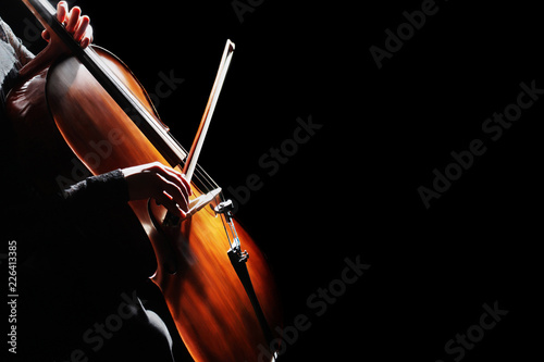 Cello player. Cellist hands playing cello Fotobehang