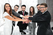 happy business team joining hands together