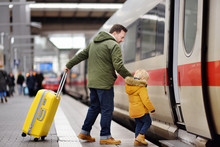 Little Boy And His Father Go In Express Train On Railway Station Platform