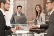 business partners talk sitting at the office table
