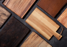 Vintage Wooden Cutting Boards Different Shapes On Top Of Black Stone Kitchen Stone Background. Top View.