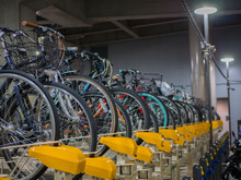 Two Rows System Of Bicycles Parking Indoor Garage Near The Shinjuku Train Station. They Be Designed For Less Spaces, More Useful Concept.
