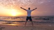 Middle aged man went up and greet sun on seashore with beautiful sunrise
