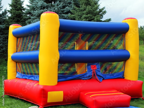 Cuadros en Lienzo Colorful square children's bounce house with reds, blues, and yellows