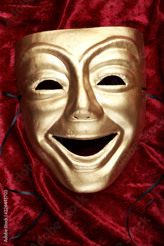 Carta da parati  Comedy mask on red velvet fabric