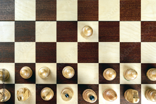 Canvas Print A pawn doing the first move on a chessboard at the very beginning of the game