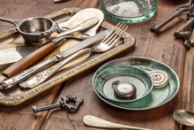 A Photo Of Many Vintage Objects, Flea Market Stuff On A Wooden Background
