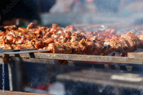 Foto op Aluminium Grill / Barbecue Grilled kebab cooking on metal skewer. Roasted meat cooked at barbecue