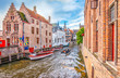 canvas print picture - Boat trip on canal of Bruges. Popular for tourists who visit Belgium.