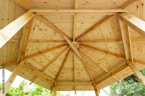 Stampa su Tela Beautiful designed white garden gazebo or pavilion roof detail under constructio