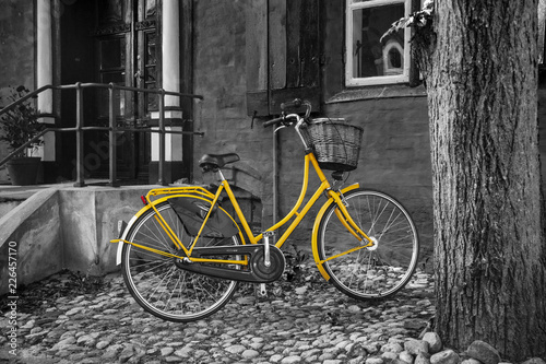 Yellow bike on B/W back