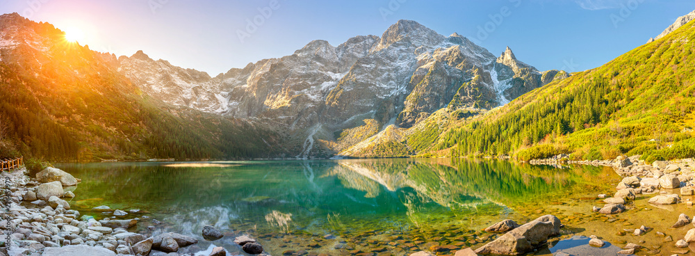 Obraz Tatra National Park, a lake in the mountains at the dawn of the sun. Poland fototapeta, plakat