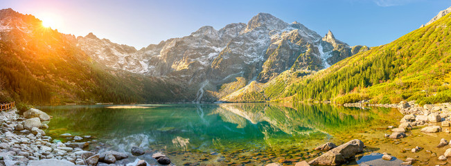 Fototapeta Góry Tatra National Park, a lake in the mountains at the dawn of the sun. Poland