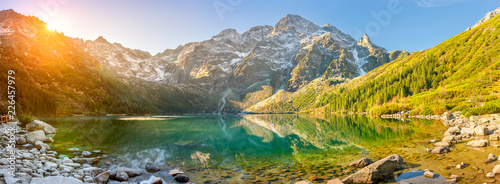 Montage in der Fensternische Frühling Tatra National Park, a lake in the mountains at the dawn of the sun. Poland