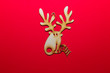 Christmas wooden toy deer on a red background