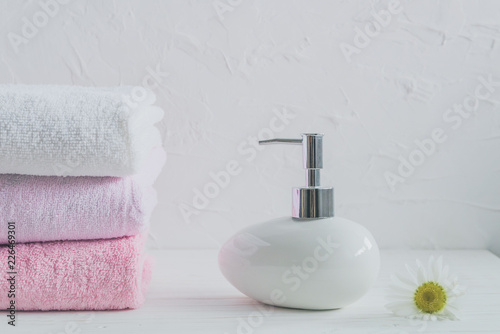Foto op Plexiglas Spa soft towels and bath soap on the shelf