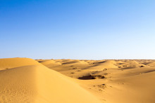 Sand Dunes In The Maranjab Desert, Near Kashan, Iran, At Sunset During A Warm Summer Afternoon. Maranjab Desert Is One Of The Main Landmarks Of The Region