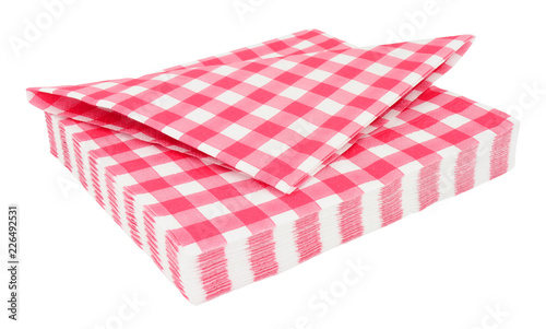 Red gingham pattern paper napkins isolated on a white background