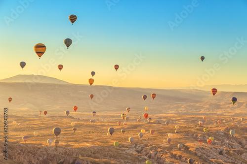 Fotografie, Obraz Amazing sunrise over Cappadocia. Colorful hot air balloons.