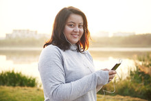 Woman Choosing The Best Song For Jogging
