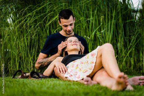 Photo  Boyfriend massaging the head of his woman