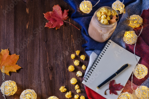 cocoa with popcorn and cinnamon on the table with an open notebook and fountain pen