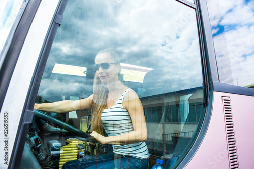 Young woman in her function as a bus driver