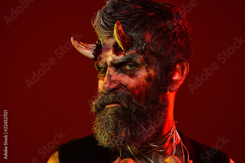 Photo  Halloween demon with bloody horns on head