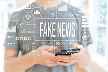 Fake News With Young Man Using...