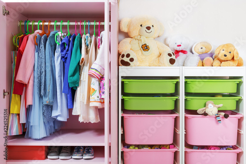 Obraz Wardrobe in the children's room. Storage system and storage for the concept of children's things and toys. - fototapety do salonu