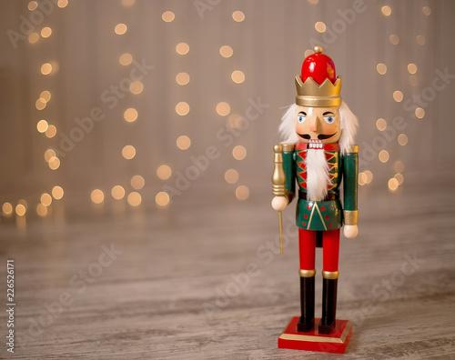 Fotografía  Toy nutcracker on a festive background