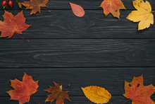 Background Texture With Old Wooden Table And Yellow Autumnal Leaves. Autumn Maple Leaves On Wooden Background With Copy Space. Top View