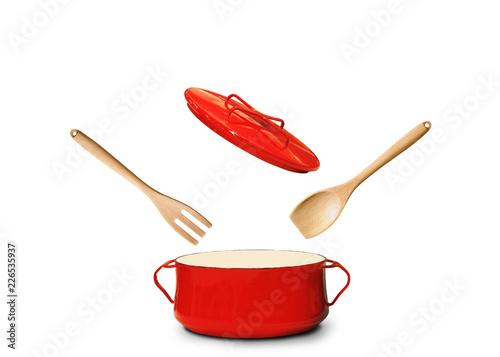 Obraz na płótnie Big red pot for soup with fork and spoon