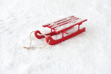 Red Wooden Sledge In Snow Cove...