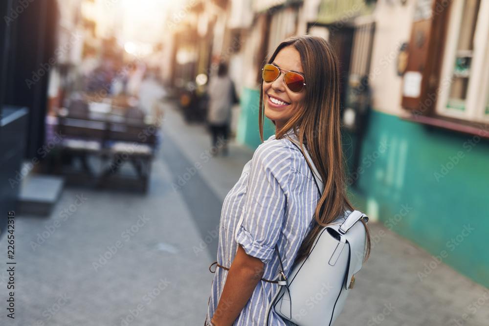 Fototapeta Female tourist in the city