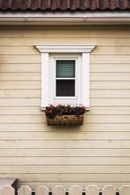 Windows Under Roof Of Modern Cottage