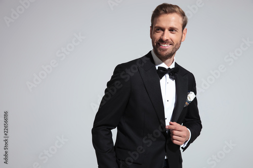 Fototapeta happy young elegant man smiles and looks to side obraz