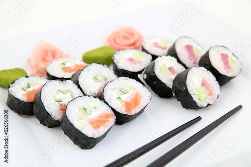 sushi set on white plate. Traditional japanese sushi rolls