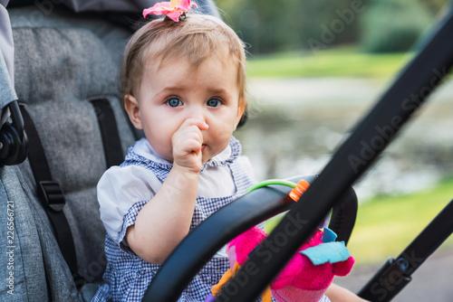 Baby sucking thumb in stroller