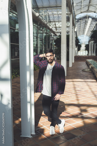 Photo of handsome man in plaid shirt and white shirt