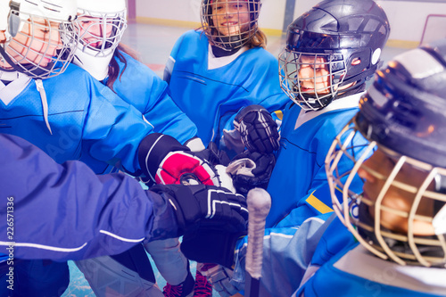 Ice hockey players putting their hands together