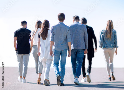 Fotografie, Obraz  rear view. group of business young people stepping forward