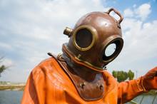 Diver Immerses In A Vintage De...